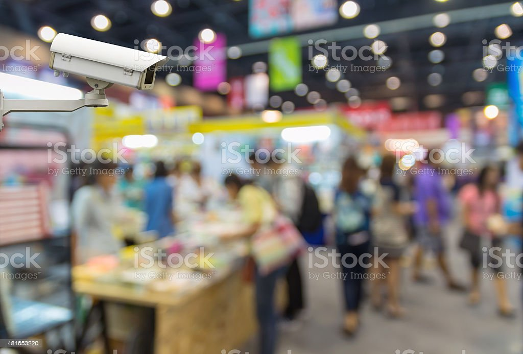 CCTV security camera on monitor the shopping center with people stock photo