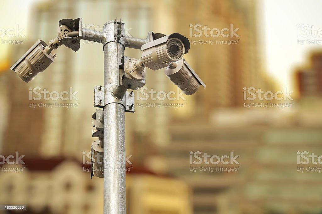 CCTV security camera on white background royalty-free stock photo