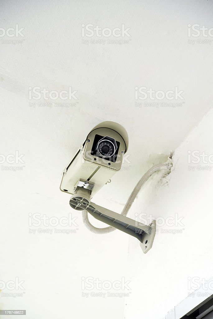 security camera on white wall royalty-free stock photo