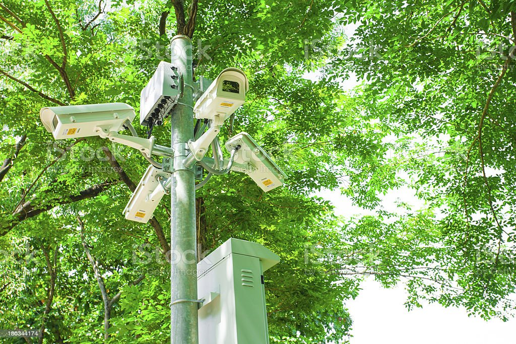 Security Camera or CCTV in green park royalty-free stock photo