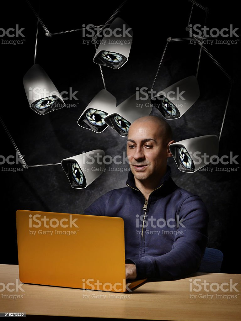 security camera spying man during cyber crime stock photo