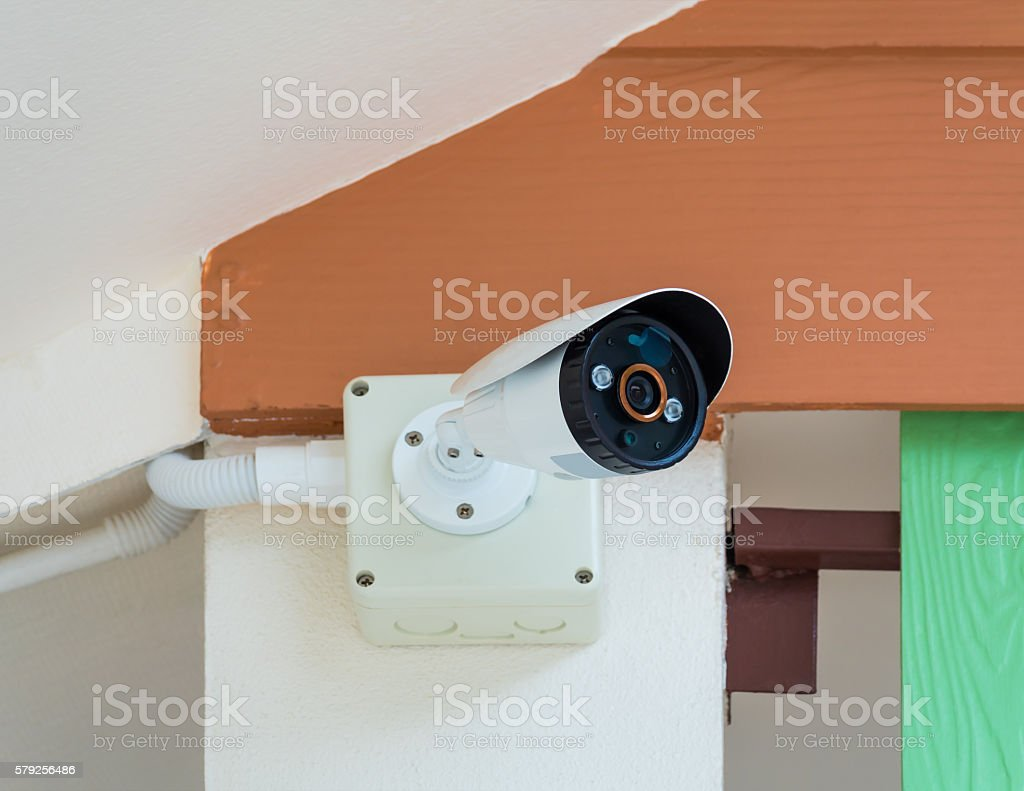 CCTV security camera under the roof stock photo