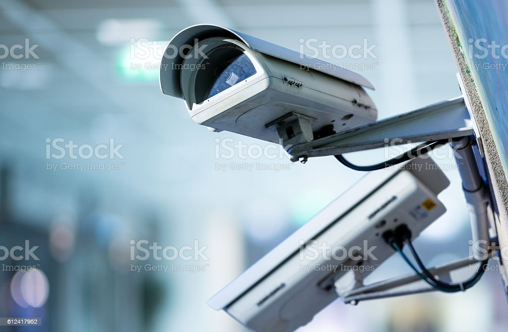 CCTV security camera with blurred background stock photo