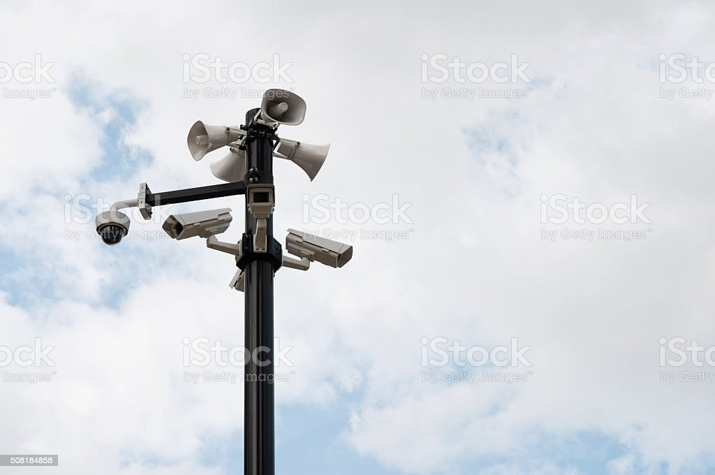 Security cameras and speakers mounted on the outdoor pole. stock photo