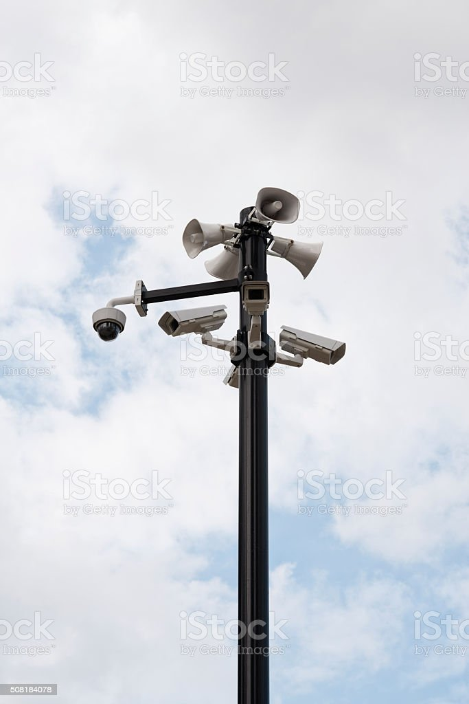 Security cameras and speakers on pole outside. stock photo
