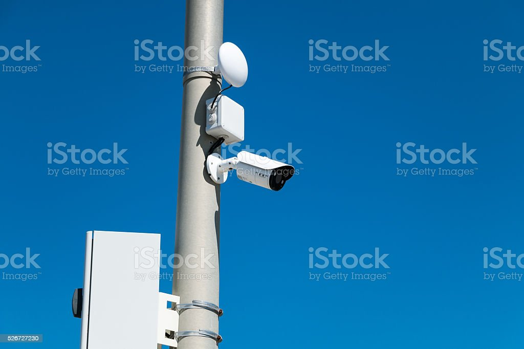 security cameras on street pylon stock photo