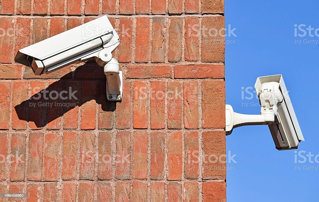 Security cameras on the brick wall stock photo