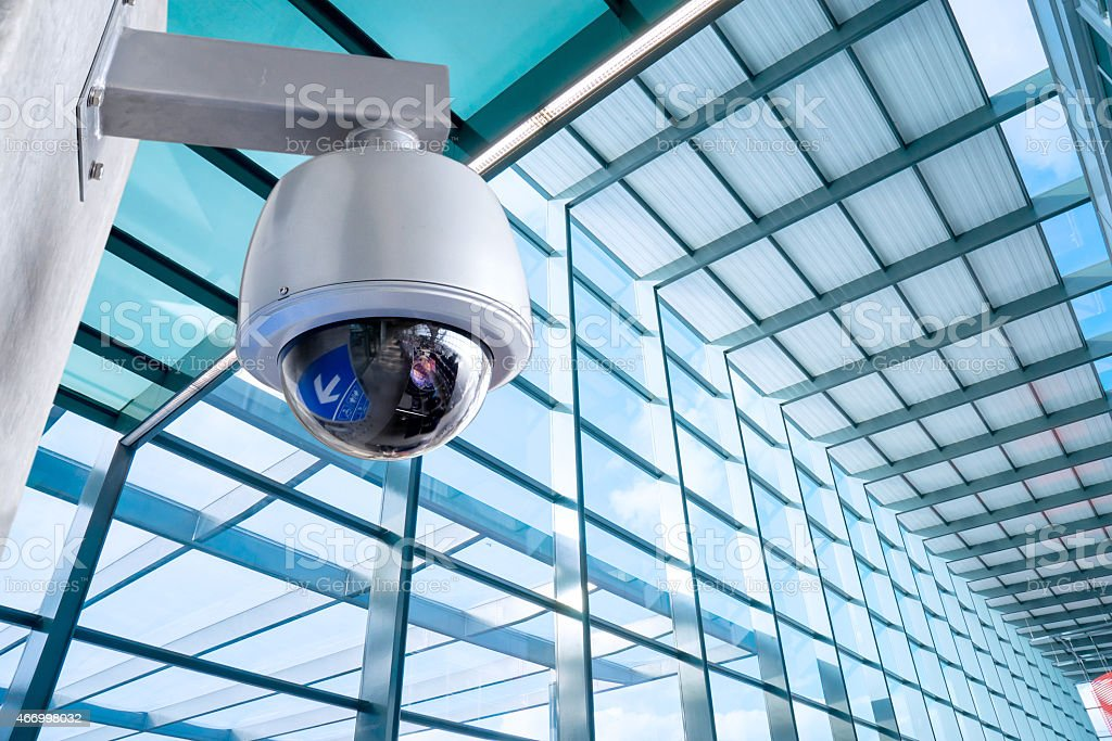 Security, CCTV camera for office building at night stock photo