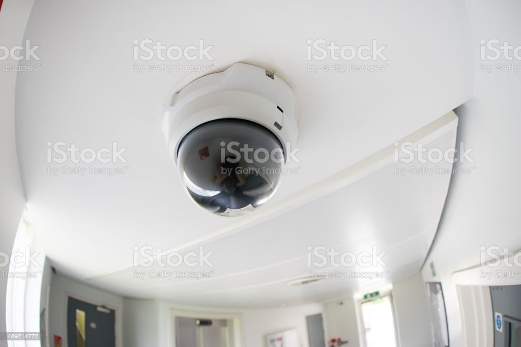 Security, CCTV camera in office building stock photo