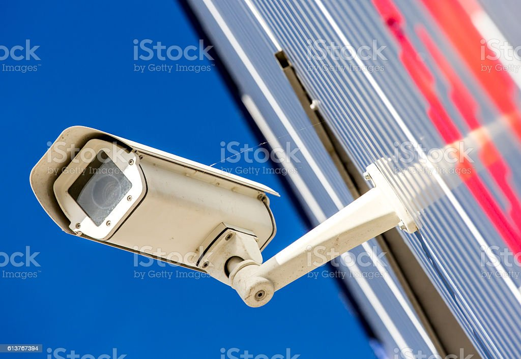 security CCTV camera or surveillance system in office building stock photo