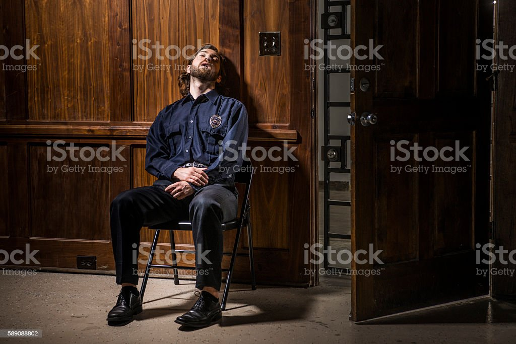 Security guard asleep at his post at night. stock photo