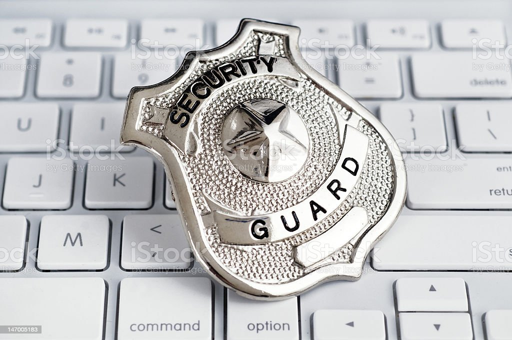 Security Guard Badge on Computer Keyboard royalty-free stock photo