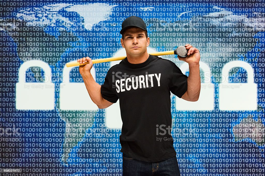 Security guard carrying sledgehammer stock photo