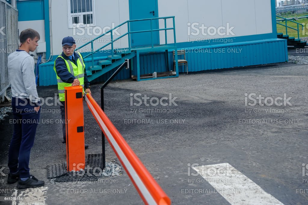 Security guard controls access to territory stock photo