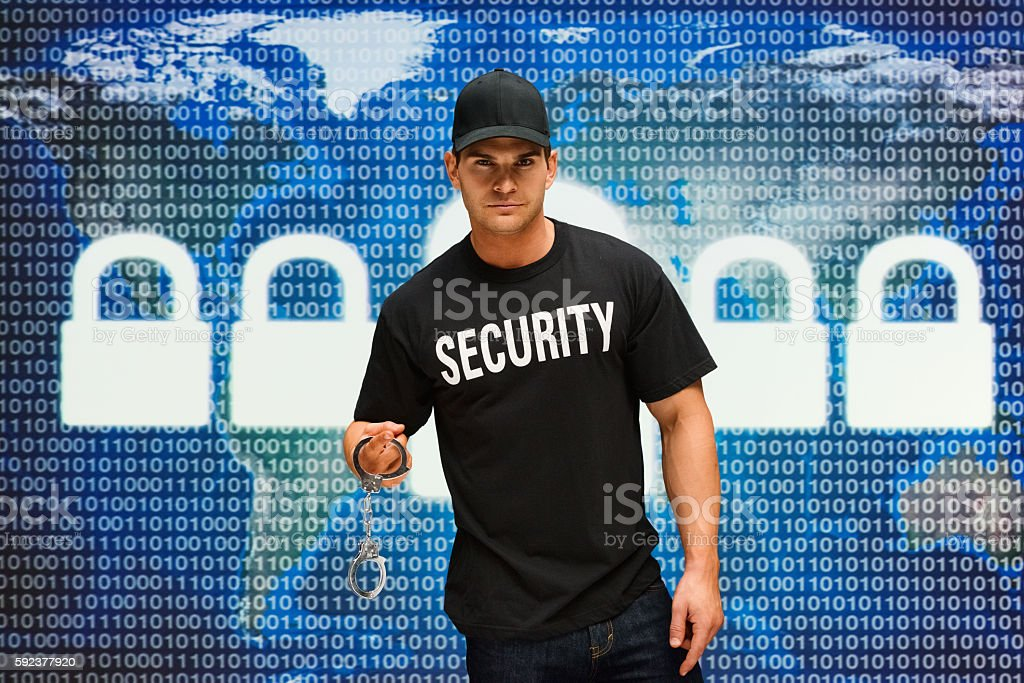 Security guard holding handcuffs stock photo