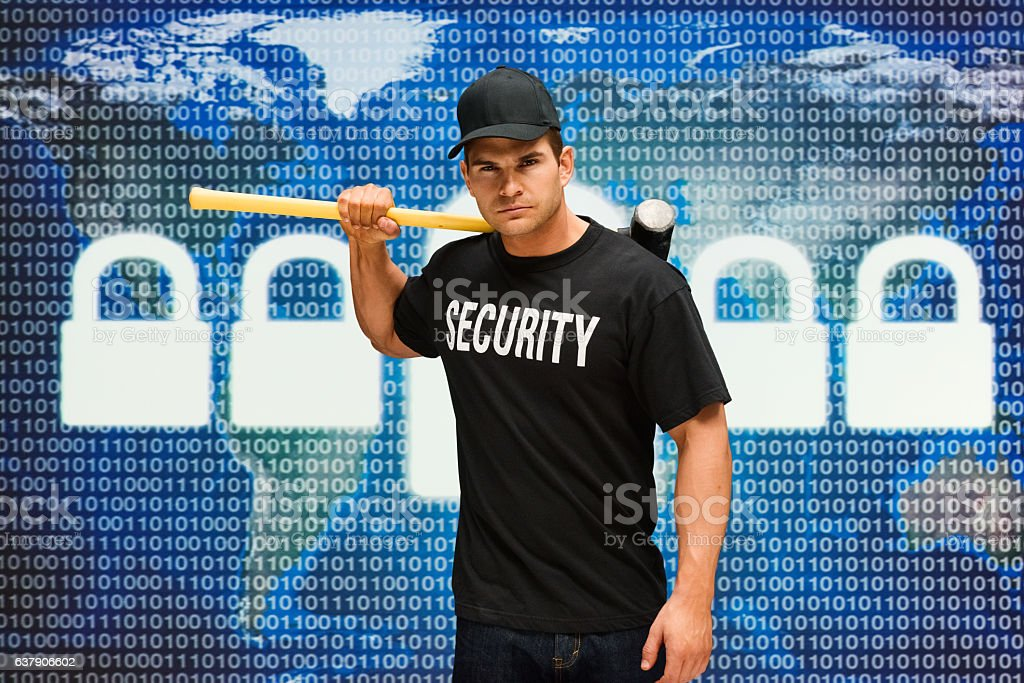 Security guard holding sledgehammer stock photo