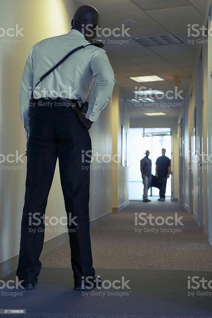 Security guard in an office corridor stock photo