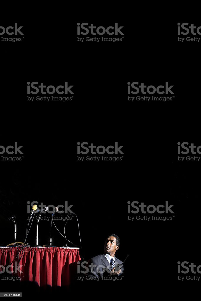 A security guard listening to his walkie talkie royalty-free stock photo