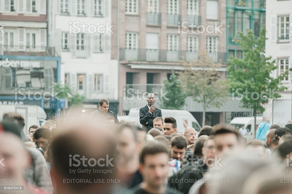 Security guard looking over crowd at Apple Store stock photo