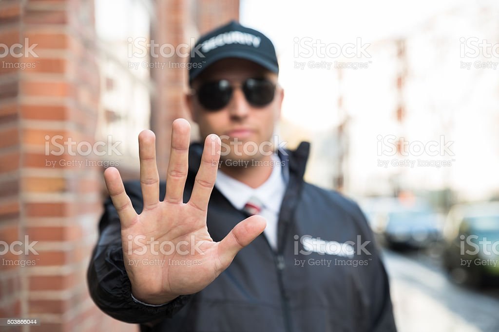 Security Guard Making Stop Sign stock photo