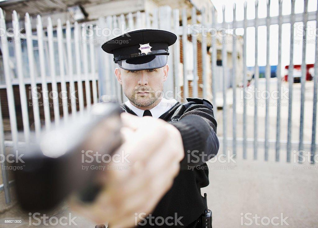 Security guard point gun royalty-free stock photo