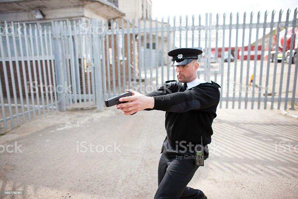 Security guard pointing gun stock photo