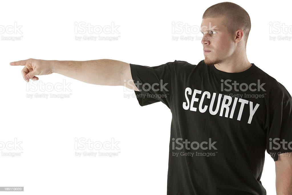 Security guard pointing sideways royalty-free stock photo