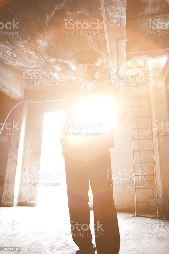 Security guard shining flashlight into bunker stock photo