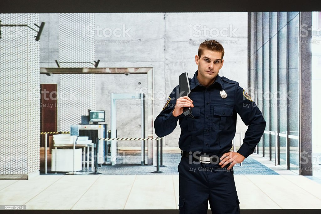 Security guard standing and looking at camera stock photo