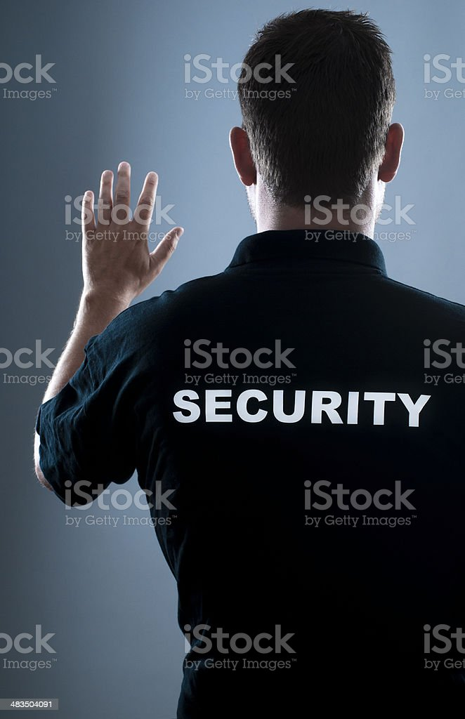 Security guard stops people royalty-free stock photo
