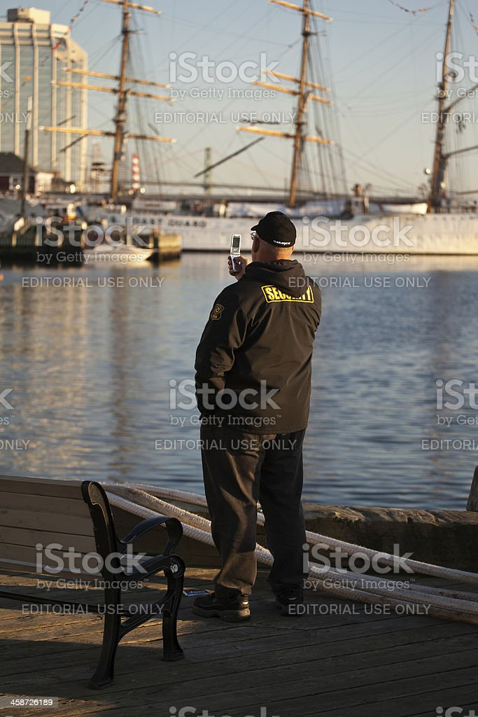Security Guard Taking Photo of Ships stock photo