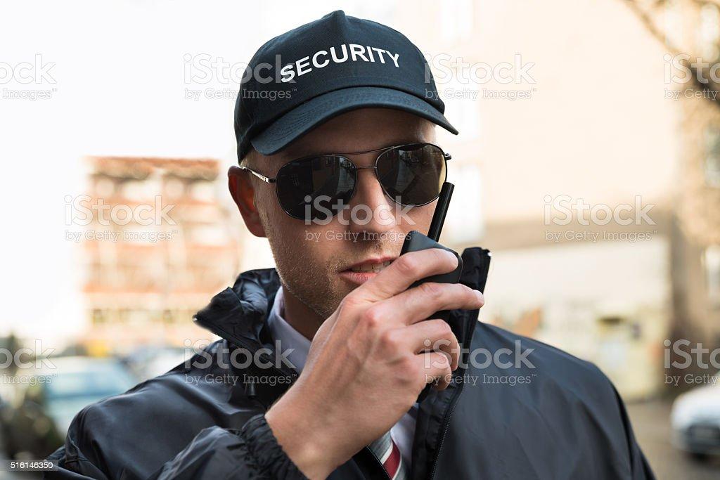 Security Guard Talking On Walkie-talkie stock photo