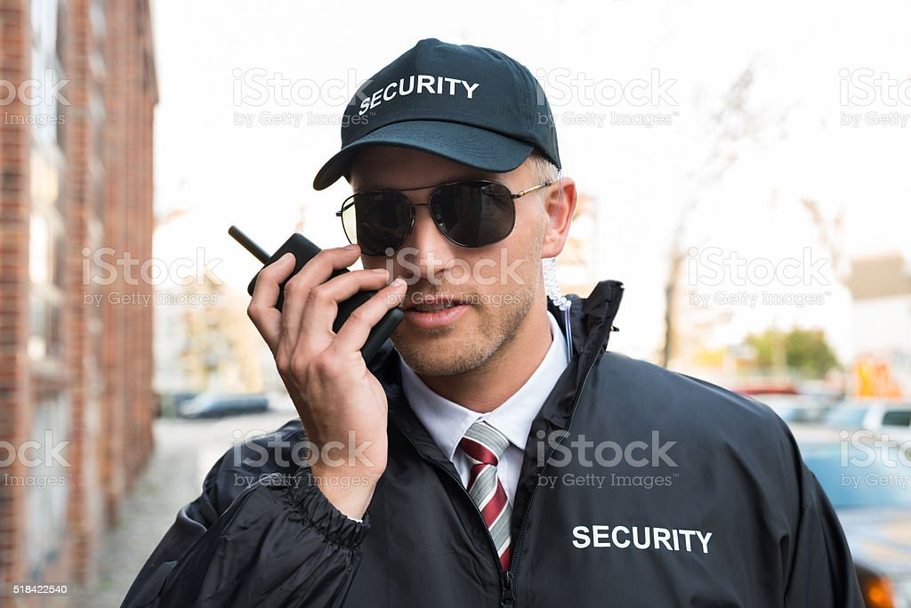 Security Guard Talking On Walkie-talkie stock photo