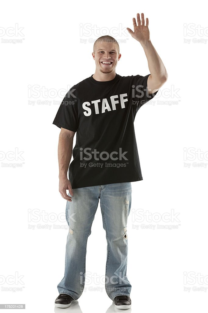 Security guard waving his hand and smiling royalty-free stock photo