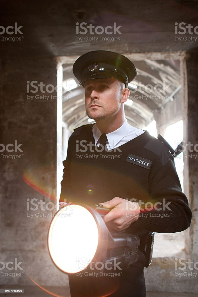 Security guard with flashlight checking bunker royalty-free stock photo