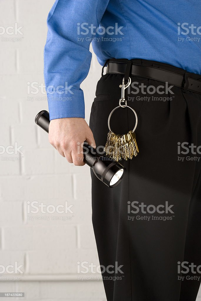 Security guard with flashlight royalty-free stock photo