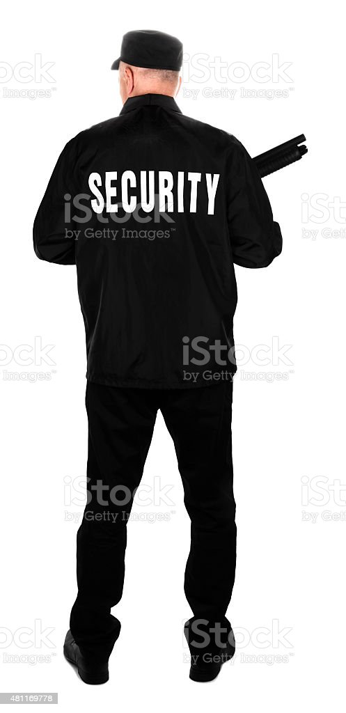 Security guard with shotgun rear view stock photo