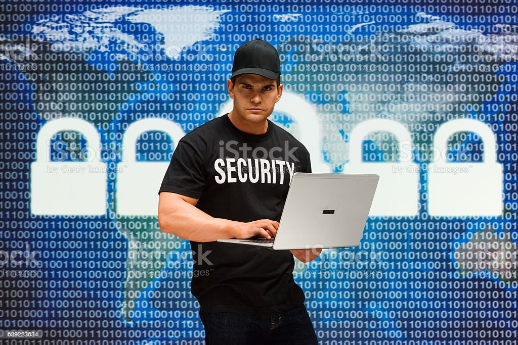 Security guard working on laptop stock photo
