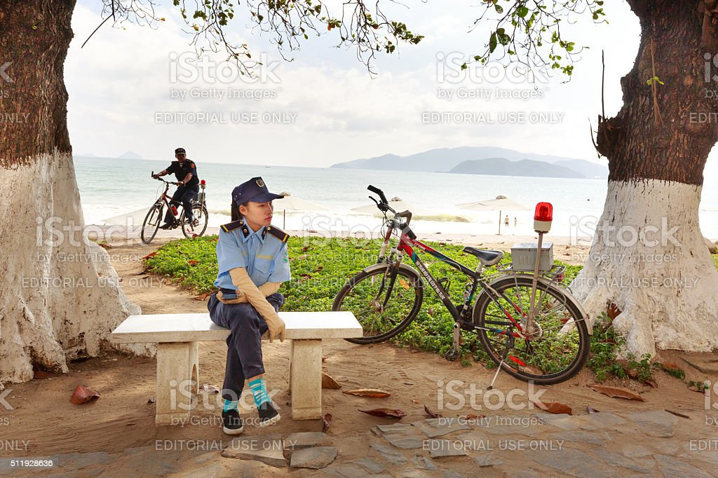 security guards at NhaTrang beach patrolling by bicycle stock photo