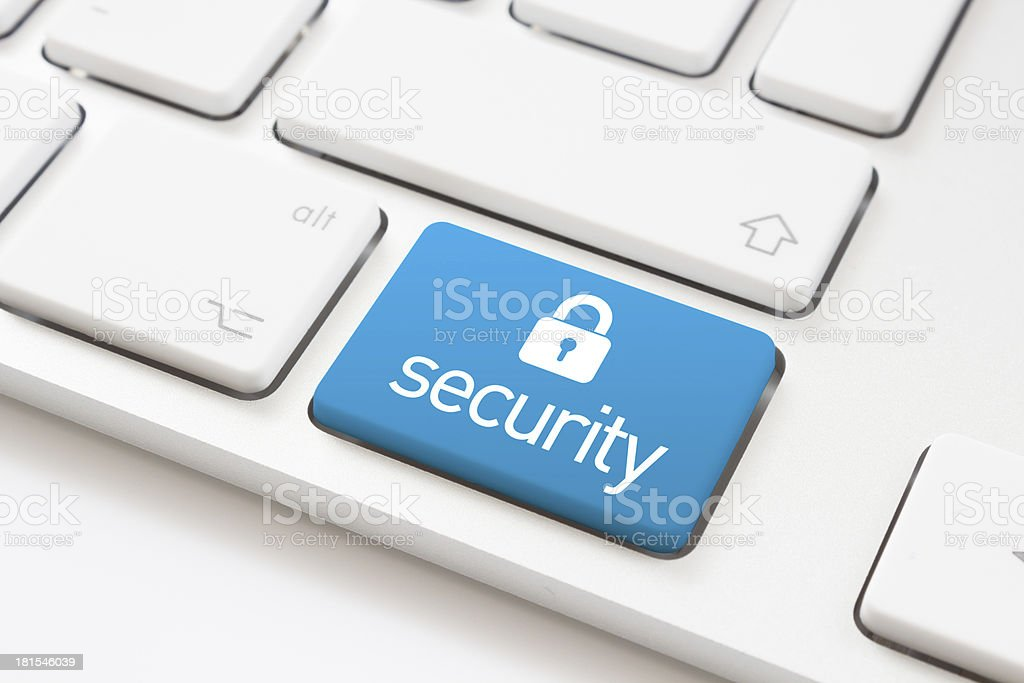 Security lock on a white keyboard stock photo