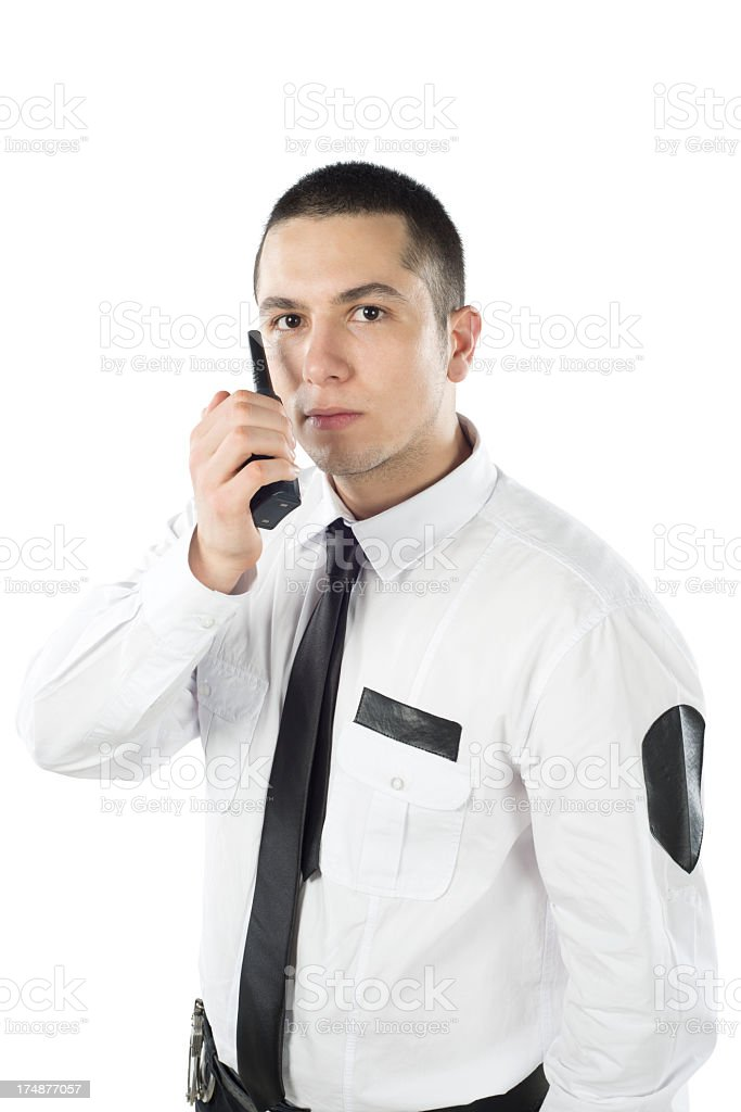 Security man holding radio to mouth royalty-free stock photo