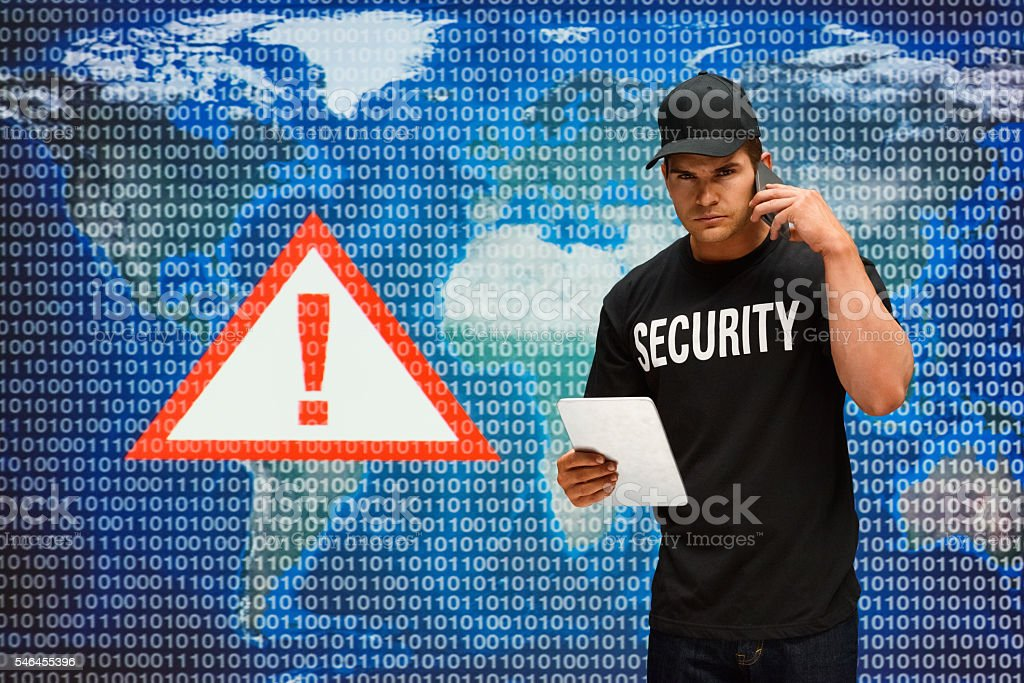 Security man on phone and using tablet stock photo