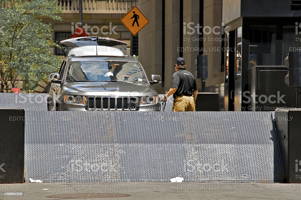 Security officer at vehicle checkpoint barrier, Lower Manhattan NYC royalty-free stock photo