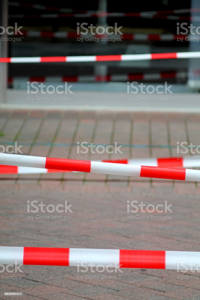 Security red and white fencing strips on the street. stock photo