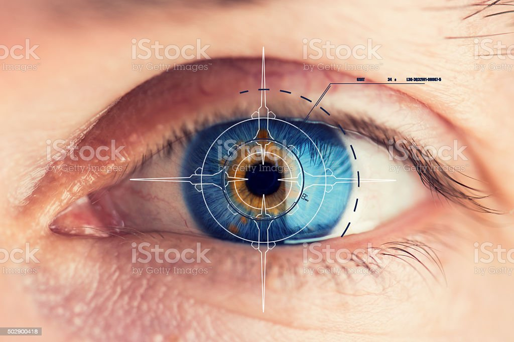 Security Retina Scanner on blue eye stock photo