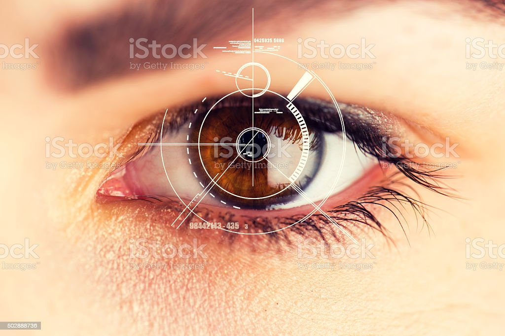 Security Retina Scanner on brown eye stock photo