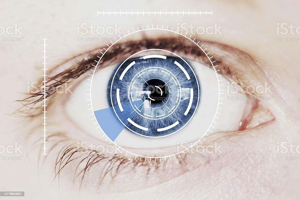 Security Retina Scanner on Intense Blue Human Eye stock photo