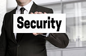 Security sign is held by businessman