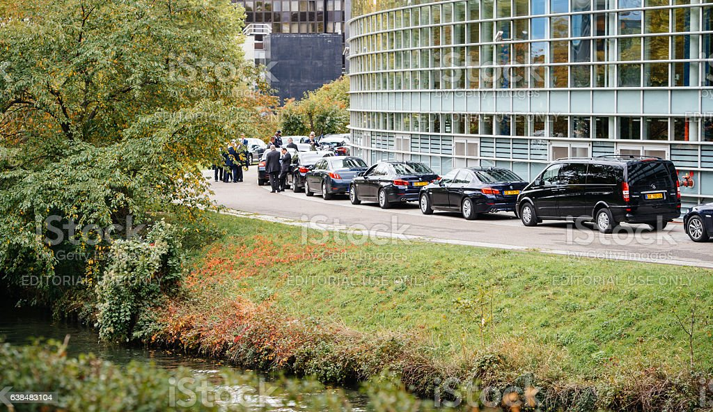 Security staff and limousine cars diplomats during President Official visit stock photo