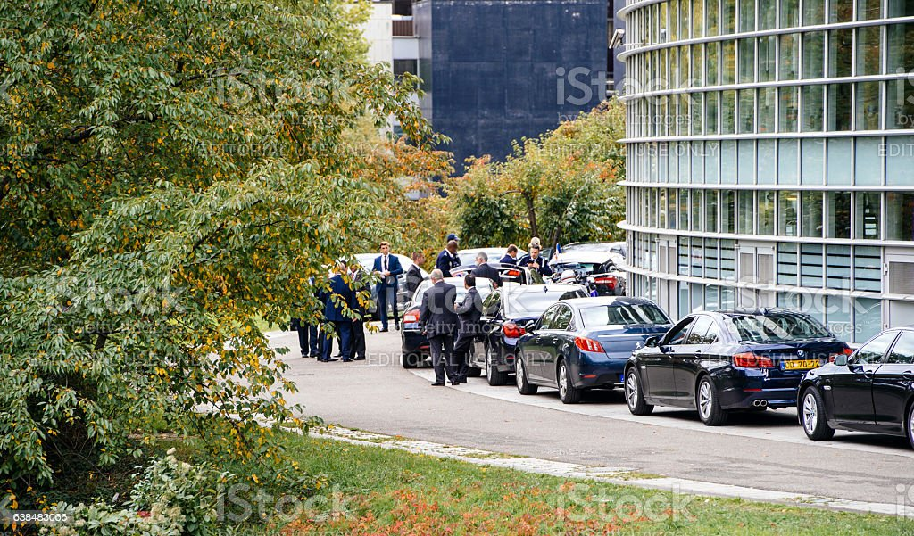 Security staff and limousine cars for diplomats during President visit stock photo
